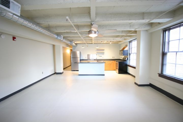 Located in the 1938-built historic Gymnasium building at The Lofts at Albuquerque High in East Downtown (EDo), this corner loft is located just above ground level on the north side of the building. The loft features an island kitchen with stainless steel appliances, concrete floors, concrete ceiling, west- and north-facing operable windows, and spacious full bath. Access to beautifully landscaped secure courtyard with grill, fountains, seating. Secure building. Common lobby area. Secure parking available at City-owned garage across the street at 100 Arno ($40/month). Association dues cover water/sewage/trash/recycling, insurance, common area maintenance, reserve contribution.