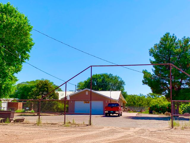 This dream property has it all. 2727sf 3 bedroom 3 bath home on 2.75 acres close to city central and convenient commute to Albuquerque.  2 separate lots. Home and Barn with stalls and pipe runs located on 1.28 acre lot. Huge 40X50 insulated shop with tons of storage built in overhead located on a separate 1.47 acre lot.  Large addition added in 2007. The bedrooms with the jack and jill bath have sitting/office areas that are just amazing. Bonus room is currently used as a game room. The possibilities are endless. Covered patio area is perfect for entertaining. Lots are fenced and cross fenced allowing for plenty of activities for everyone. There are 3 large storage containers with covered storage for all your toys. . Come check it out before it's gone! Irrigation Possible through MRGCD