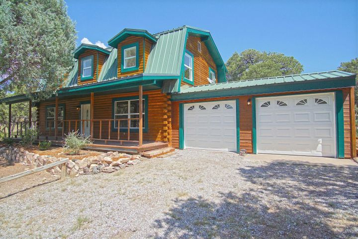 Come check out this charming Log Cabin home in Tijeras before its gone!  Enjoy the wooded forest on 2 acres of land with LOTS of new upgrades! New water heater, laminate throughout, solid oak doors, electrical panel, zoned radiant floor heat, garage doors, newer windows. Fully upgraded kitchen with breakfast nook, farm sink, new SS appliances, granite, & new soft close cabinets. Bathrooms have been fully renovated. High vaulted ceilings in the master, two closets, one is a walk in. Exterior of the cabin has been freshly re-stained & finished, & has a metal roof. The property has a private septic & well that have recently passed inspections, with a brand new well head & concrete slab installed. The property includes a chicken coop, a long covered front porch, storage shed, and tons of space