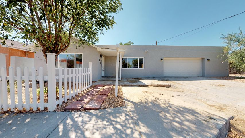 Welcome Home! Wow! Beautifully remodeled home in highly sought after downtown location!  Check out the virtual tour! This perfect live/work space has 2 bedrooms plus a possible 3rd bedroom or study/office.  Located at the end of a cul-de-sac, this tastefully renovated home features brand new HVAC with REFRIGERATED AIR and heating combo unit, new roof, upgraded electrical panel, all new flooring throughout, new synthetic stucco, new 2 car garage, gorgeous custom kitchen with new cabinets, stainless steel appliance package and granite counters in all wet areas, new windows, new low-maintenance southwestern landscaping!  You must see to appreciate!