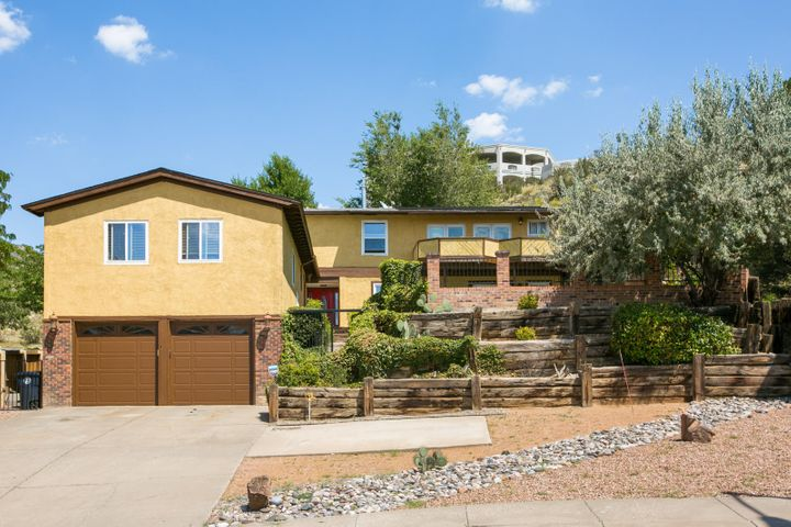 Sitting at the base of the foothills on 1/3 of an acre, this spacious 5 bedroom home offers breathtaking views of the city and mountain views. The front of the home has a security gate that leads up a beautiful courtyard pool area.  Inside, the home features a large open kitchen with granite counter tops, multiple living areas, and a private two bedroom suite above the garage.  Roof was replaced in 2013 and a home inspection was performed in 2018 with more home information.