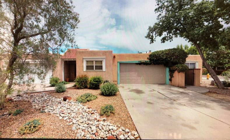 An Amazing property located in the Albuquerque Country Club area possible revenue generating AirB&B. Updates have been made throughout this property. 2 Bedroom 2 bath with an option for a 3rd bedroom, office, sunroom, or you can convert to a large pantry. The living room offers 12ft ceilings with wood beams and corbels, enjoy a fire in your gas burning fireplace with Rock wall and a wood mantle.  New carpet, tile and Bamboo flooring throughout the home. Updated kitchen with granite counters and stainless steel appliances.  The master bedroom offers his and her closets, his and her sinks with corian counter tops, the walk in shower has also been fully updated. Enjoy your evenings in your own little garden patio. This property has much to offer, close to downtown, nightlife and entertainment