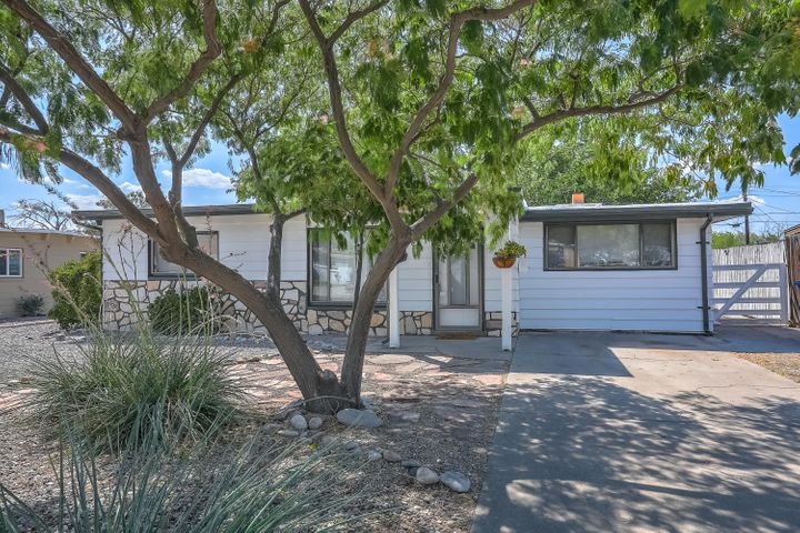 Beautiful charmer in Uptown Albuquerque.  This 3 bedroom, 2 bath home features 2 separate living areas, a spacious  kitchen, and a cozy wood burning fireplace.  Well kept tile, carpet, and wood flooring throughout the home.  Private xeriscaped backyard great for entertaining or relaxing on warm fall evenings.