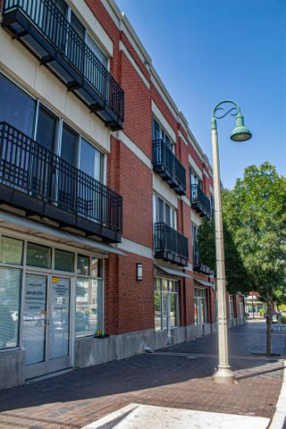 Beautiful condo in Downtown Abq located on the main floor of a gated community. Zoned for live/work. Large open kitchen/living area with stainless steel appliances, newly replaced in June of 2019. Stained concrete flooring with 12' ceilings and exposed duct work. Utility closet has stacked washer/dryer and extra storage space. California closet in master bedroom.  Front room is perfect for an extra bedroom or work space.  Walking distance to shops and dining! HOA covers common area, roof, exterior of building, access gate system in front, elevator, pool, landscaping, insurance, water, sewer, trash and monthly exterminating.