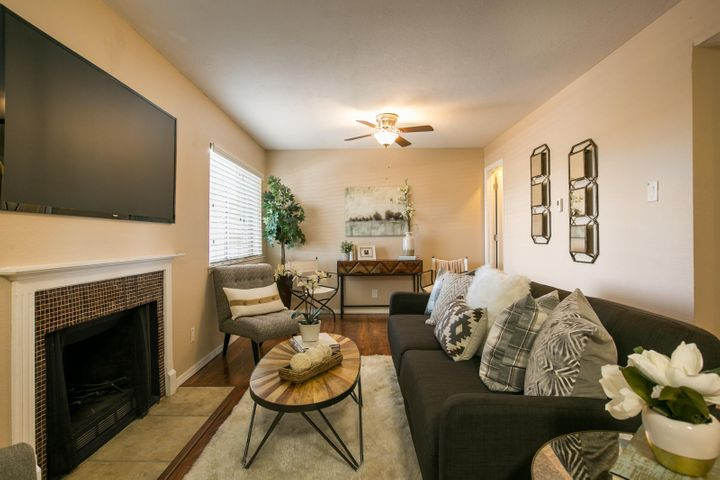 Fabulous updated 3 bedroom condo in a gated community in the NE Heights!  This beautiful condo has newer wood looking laminate flooring and carpet, paint, kitchen cabinets, counter tops and bathrooms.  The living area has a cozy fireplace and balcony. This unit comes with a washer/dryer.   HOA COVERS SO MUCH...taxes, electric, water, sewer, trash utilities, security gate, pool, clubhouse, fitness center, elevator, common area maintenance, and more!  Covered parking available for a monthly fee.  Owner finance terms would include at least a 10% down payment.
