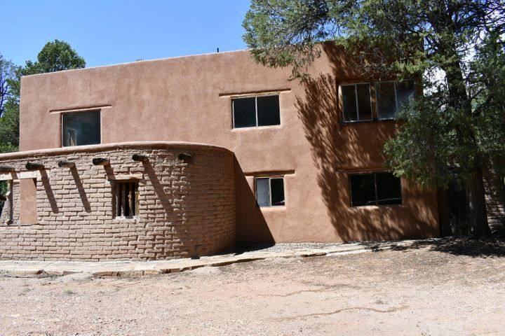 Major Price Improvement! Northern New Mexico adobe needs updating, but wow!  What a find.  Living room with tall pine ceilings, cozy family room, and knock your socks off views from the fabulous sunroom.  Three bedrooms, 2 baths.  Extra large kitchen with nice dining area.  Covered patio for barbecues in the rain.  Close to everything you want - the Jemez River, hiking trails, and night sky gazing.