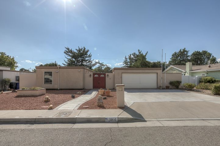 Very cool home with a mid century modern feel! Enjoy all the modern updates juxtaposed with the original wood floor and custom built-ins. Sliding glass doors open from the dining room and living room directly into the courtyard. A perfect design element if you enjoy entertaining outdoors. The courtyard is filled with rosebushes and other mature plants. On the back side of the house you will find your own personal putting green! This home was well loved and pride of ownership shows! Come make this house YOUR home!