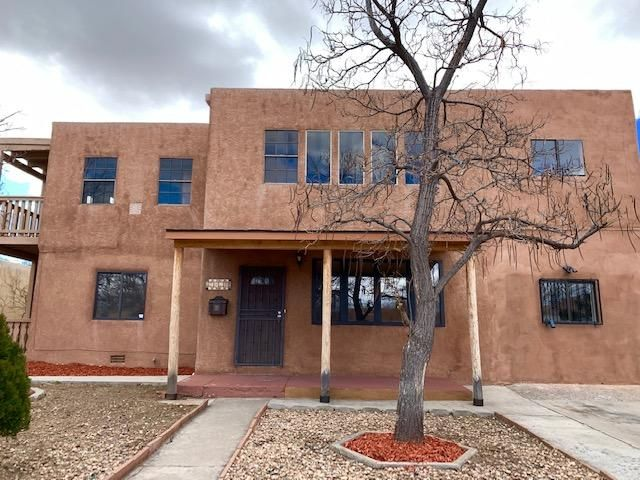 Huge property located close to UNM and Nob Hill. Great for a large or extended family or the possibility of investment/rental income. So many options with such a spacious floor plan and layout. See if it will work for your needs.