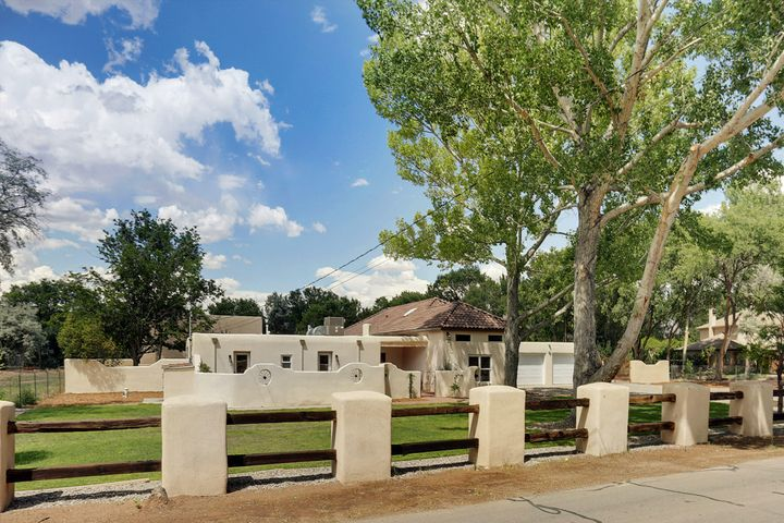 Amazing Remodeled Adobe Home nestled on 1.07 acres. 11' T&G ceilings w/ Vigas, 3 gas fireplaces, pre-wired networking w/ wireless repeaters, nest thermostats, Ring doorbell, & speaker system. Vent hood, stove, ceiling fans, blinds, garage doors & Irrigation that can be controlled through smart hub or smartphone. 2 master suites both w/ fireplaces, walk in closets, & open to courtyards. Main master has double sinks, jet tub & separate multi head shower. Custom cabinetry throughout the home. Kitchen with 5 burner stove with 2 ovens & 2nd built in oven & microwave. Granite, eat at island, instant hot water, quartz counters & walk in pantry. 2200 sqft detached, insulated 6 car garage/workshop with RV parking & 14' ceilings. New septic, well, 2 ac/heat units, & roof. Amenities list attached.