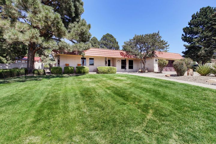 Beautiful Single Story Home on a Large Corner Lot with Tall Pines and VIEWS!   Updates - Pella windows 2010 , TPO roof 2015, shaker doors and trim 2013, +++ and luxuriously remodeled baths 2014! 2 living areas and 5 nice size bedrooms all with walk-in closets! Master Bedroom is open backyard and has an award winning best bathroom design in 2015!  Kitchen is remodeled with SS appliances lots of cabinets and sunny Breakfast area!  Spacious Family room has a cozy fireplace, built-ins and open to lush backyard. Backyard comes with an In ground Gunite Pool w diving board, slide, safety winter cover and self-cleaning system, Tuff storage shed, covered and open patios, Mountain VIEWS, side-access/RV Parking.  In Four Hills with Country Club and Golf course! COME SEE!