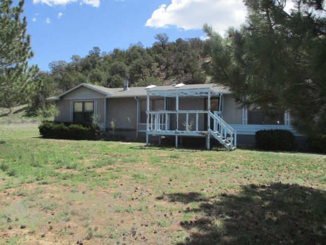 spacious manufactured home located on 2 acres. Peaceful mountain living awaits you! Plenty of room for both indoor and outdoor hobbies. Give this home a look!