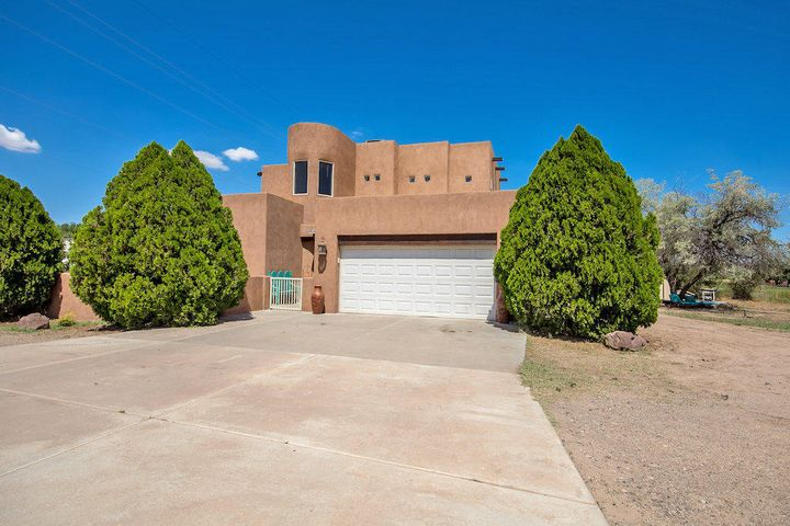 Seller is moving - their loss is your gain! Custom home on 1.25 ac w/drive-thru, insulated 40x60 barn. Impressive entry leads to a comfortable Great Room, perfect for entertaining; windows fill the Living Room offering lots of natural light and a great view while the bar provides a great space to visit with the cook while they work. Kitchen is a chef's dream - loads of custom built cabinets & ample counter top space. You'll also find a Master Suite, two more bedrooms and guest bath downstairs. Upstairs is the private Owner's Suite with versatile loft, amazing bathroom complete with jetted tub/separate shower, huge walk-in closet, views of the surrounding farm land and separate study. Enjoy the great outdoors under the patio and pergola and search the night sky in the hot tub.