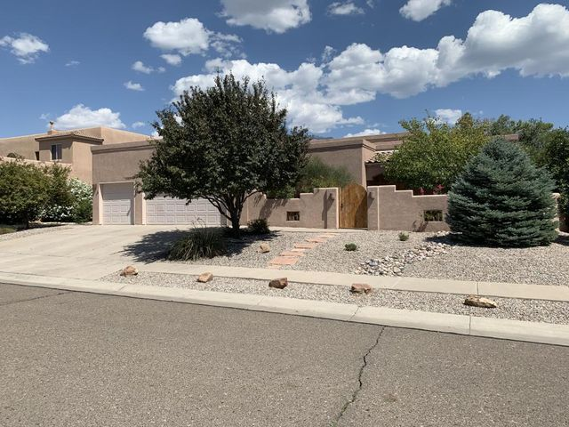 This custom, 4bd, 3ba two owner home is waiting for you. From the welcoming and peaceful courtyard, enter the foyer with raised ceilings, open concept and flowing floor plan. Main living area/family rm is 23x18sf, w/ custom kiva and is open to the kitchen and dining room. Kitchen offer lots of natural light coming from the wall of windows and skylight. Large pantry, SS appliances and eating bar. 4 spacious bedrooms. Nice MBD with walk-in closet, skylight and dbl sinks. Basement has 3/4 bath, wired for surround sound, heated/cooled with storage closet.  Relax in the private bkyd under the covered patio. Bkyd has side-yard access & both front and backyards professionally landscaped. Neutral colors throughtout