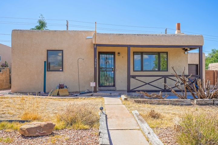 Welcome to Nob Hill/UNM areas! A little fresh paint will go along way for this wonderful home. Features include Heating/refrigerated air unit, beautiful Pella windows (w/ built in blinds), lots of natural light,  hardwood/laminate floors, updated kitchen, two wood burning fireplace(s) for comfort and a newer hot water heater...attached garage, too! This 3 bedroom, 2 bath home offers 2 warm and inviting living/family areas (both with fireplaces). This home alos offers a separated bedroom floorplan. Property is located in close proximity to UNM, Puerto Del Sol Golf Course, parks, public libraries, restaurants and Kirtland Air Force Base.