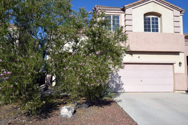 Large Family home in Great Location across the street from Soccer Field and near Volcano Vista HS.  Don't miss the View of the Sandia Mountains from Upstairs.  A little TLC can make this one shine.  Quiet neighborhood with quick access to Shopping and recreation.