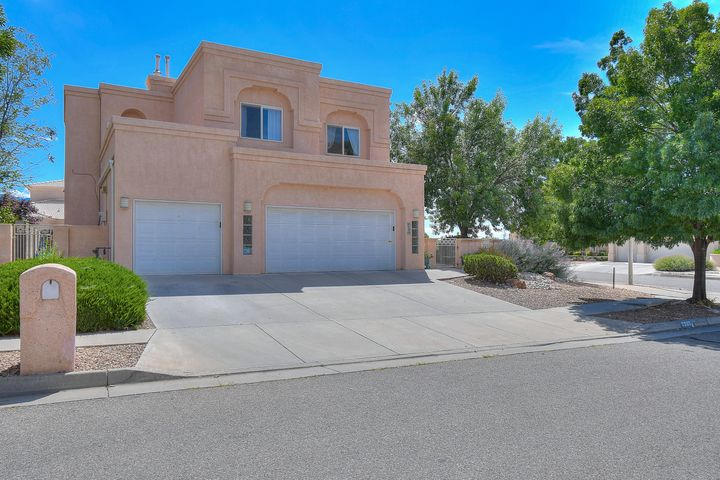 Incredibly Beautiful 4 Possible 5 Bedroom, 3 Full Bath, 3 Car Garage Stunner in La Cueva School District!Located in the premier community of Vineyard Estates, situated on a prime corner lot with a beautifully landscaped gated courtyard leading to the large backyard featuring mature trees and plush grass. Upon entry to this magnificent home you will be greeted with a bright open space featuring cathedral ceilings brimming with natural light which accentuates the beautifully appointed staircase & architectural features.  The luxurious master suite is impressive with its own balcony and jetted tub you may find it hard to leave this private retreat. The upstairs is finished with two more oversized rooms and a very large family room & 2nd balcony. 4th bedroom and full bath downstairs.