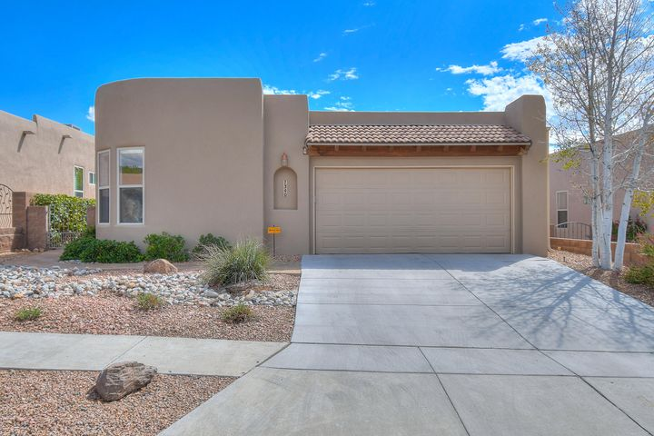 Welcome to this lovely Skyview/Scott Patrick home in the gated Estates at Desert Ridge Community.  This home features a light & bright open floor plan with radius walls, tall windows and numerous skylights throughout.  Updates include synthetic stucco 2018, brand new carpet and recent paint in some areas.  Large living area with a gas fireplace is open to the kitchen and dining area, perfect for entertaining.  Kitchen offers lots of great great storage as well as granite counters and stainless steel appliances.  Master suite features a generous master bath with dual sinks, garden tub, separate shower and walk-in closet with built in shelving.  Office/study has glass french doors and a closet which gives you a few different options for this space.   Great backyard with covered patio too.