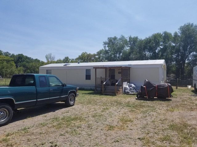 Welcome to a private and beautiful setting in Los Lunas just minutes from Hwy 47 (off Hwy 63). This mobile home sits on 1 acre! It has 3 bedrooms, 2 baths, and all appliances. Evap cooler, storage shed, propane. It is a single wide mobile home built in mid 1990's. It is not on a permanent foundation. The setting is beautiful with lots of trees and acequia nearby. Restaurants and schools close by. Owner financing available. Call for a private showing!