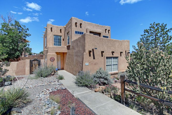 You have to see this beautiful southwestern style home located in a highly desired west side neighborhood near the Mesas. Lovely wooden accents throughout the home. Gas log Kiva fire place in living room. The kitchen has a unique pantry, stainless steel appliances and tile. New carpet, new roof fresh paint.  Master has walk  closet and mountain views from the deck. Adjacent bedroom also has a deck with stairs that lead to the covered porch in backyard. Beautiful cactus surrounding the home.