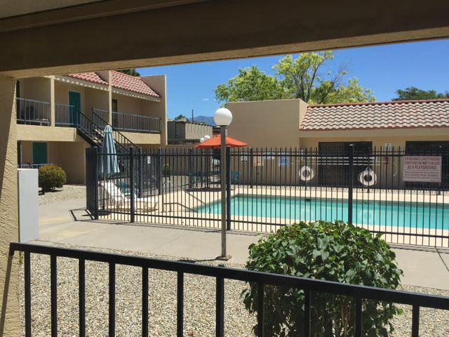 This is a very nice condo located in a gated community in Southeast Albuquerque. This property is very close to the VA Hospital, Kirkland Air Force Base, UNM , CNM, Sunport, shopping and restaurants.  This condo faces the pool, which is covered by the HOA. The HOA also covers the common areas, and exterior of the building. The utilities are very affordable as they are split between the 30 units.