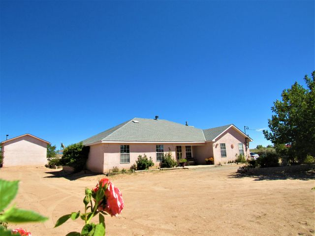 Gorgeous property with great views and privacy on a well cared for 1 acre lot surrounded by 52 rose bushes! This could be your own slice of New Mexico paradise. Single level home with custom cabinetry, 2 huge walk in closets in the master, 24x22 man cave/she shed in the back and 16x12 storage shed. Relax on the covered patio and take in the views in the summer and snuggle up next to the fireplace in the winter. Schedule your showing today before it's gone!