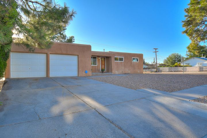 NE Heights living at its best! This NM beauty is part of the Eldorado HS district! Recently remodeled and boasting a large kitchen with lots of counter space, under cabinet lighting, stainless-steel appliances, and two pantries. Adjacent is a formal dining room with eye catching fireplace, perfect for centralized entertaining. Beautiful, refinished original hardwood floors in living, bedrooms and hall; newer hardwood in the dining! Gorgeous bathrooms with cultured marble and a deep soak tub in the guest bath! Refrigerated AC, 2 stage furnace, tankless water heater, and upgraded electrical service! Newer roof (2016). Vinyl double pane windows and fresh paint throughout. Spacious corner lot with back yard access, perfect for an RV. 2 Car garage with lots of storage space. Move in ready!