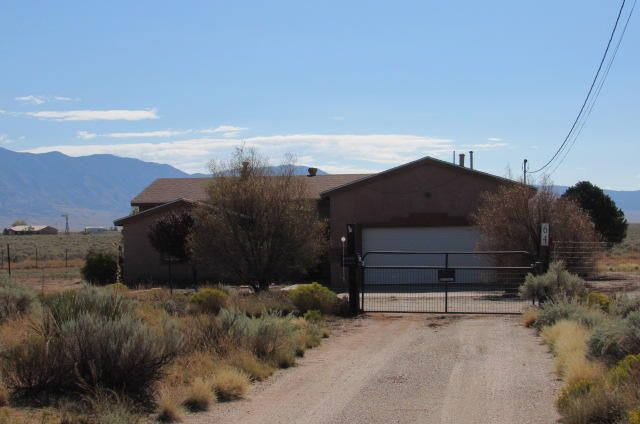 This property is located on over 8 acres and has amazing VIEWS of the Manzano Mountains! Nice floor plan and layout with a large living area open to the kitchen. NO carpet! Roof was just replaced. Termite, well & septic inspections completed.