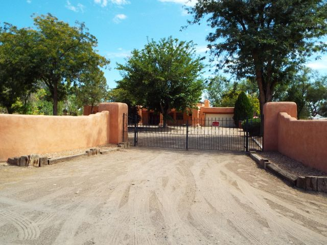 ADOBE Style Ranch house, 3 bedrooms, 3.5 bath, on 3 acres in beautiful Peralta.  Tall Cottonwood Trees outline this unique, one of a kind property.  Sunken LR, high ceilings with beams, sun room with back court yard leading to stalls and workshop.  Perfect horse property.