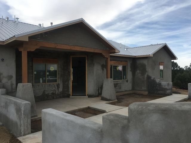 **OPEN HOUSE SAT 10/5 12-2pm** Be in your brand new home by the holidays! Still time to select some finishes. Single-level, steel roof, courtyard, covered back porch, high-efficiency HVAC refrigerated air (95%), full laundry room, skylights, over-sized garage with large storage space above, closets galore, pellet stove with thermostat. Tongue & groove vaulted ceiling throughout open-concept living areas. Thoughtful details and included upgrades make each Easley Custom Home feel like a model. Wooded and meadow two acre lot is a gorgeous setting with nice views of South Mountain. Paved roads, underground utilities, community water, excellent access to highways. Builder is VA approved.