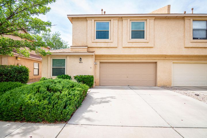 Gorgeous Townhome ideally located in North Albuquerque near shops, restaurants and I-25! Pride of ownership! This beautifully updated 1436SF town-home has 3BR's, 2.5BA's, 2CG, gas log Fireplace, New Roof in 2017, New dishwasher, oven, microwave and range-hood all in 2019! Nicely landscaped backyard with open patio, grass, shade tree and recently installed landscape lighting! The kitchen has newer quartz counter-tops with nice tile splash and cabinets! Newer Windows too! Updated fixtures throughout! Low HOA fee of $37.00 per month covers the front landscaping and common areas!