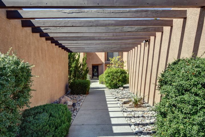 Gorgeous townhome located in SANDIA HEIGHTS! Refrigerated air, newer appliances, tile floors, and more.  Each bedroom has a private balcony and one of them has stunning MOUNTAIN VIEWS! Come & see this well kept cozy 2 bedroom home before it's sold!