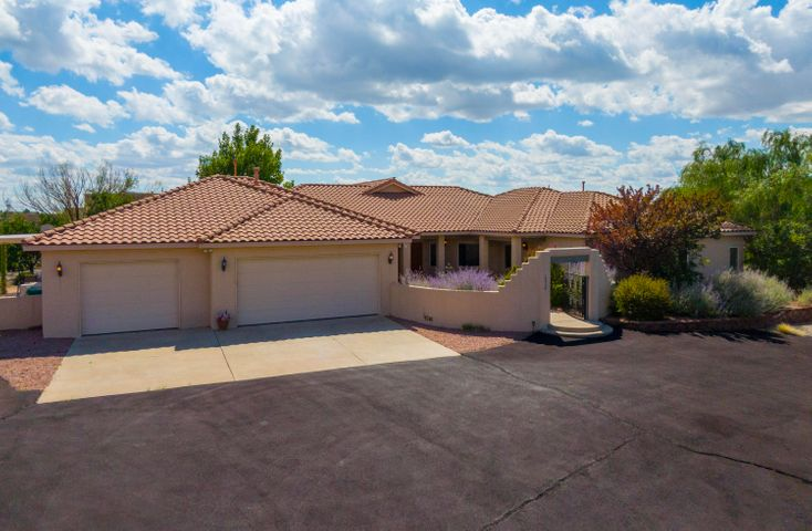 Custom home w/in a cul de sac on 0.89 ac in N.ABQ Acres. Perimeter of prprty is fncd in w/ 8ft chain length to keep fur babies in & critters out.Mature trees shade an amazing Frnt & bkyrd. Enter this SW Contemporary Home by solar operated life mstr gate system w/ access to 3 car ga from horse shoe asphalt dr wy. Lrg Crtyrd, mtn views, raised garden beds w/fruit trees, Hot Tub & 2 cvrd patios for outdoor lvng w/plenty of rm for toys/RV/boats. Open flrpln ftrs vltd clng w/T&G wood beams, foyer gallery entry, grt rm w/gaslog fp, frml dining rm w/built in wet bar, gourmet kit w/ss aplncs, granite cntrs,dbl pantries,brkfst bar/island,butler's pntry & nook.Mstr ste w/fp has bonus sitting rm. Addtnl stdy compliments 2 lrg bdrms & is potential 4th bdrm,wood drs & lrg accommodating storage thr/out