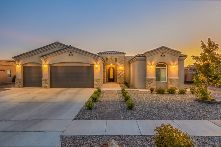 Custom home in beautiful Unser Cliffs Community-has it all!  Great Open Floor plan with many upgrades you come to expect with a custom home. 4bed/3bath 2590 sqft.  Gourmet kitchen with built in appliances,  which will Convey and include full size side by side Refrigerator/Freezer built in combo.  Spacious living area with a gas fireplace, custom tile work throughout.  Enjoy Tranquility in the master bath with full size garden tub, his and her vanities. Fully landscaped front yard and block wall, gazebo, fire pit, pavers and covered patio in backyard.  Did I mention this has backyard access and no HOA? come tour this gorgeous home this Saturday for your opportunity to have your dream home.