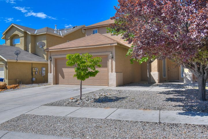 This beautiful home in NW Albuquerque features large backyard and open floorplan.  Front entrance opens into large living room that leads directly into the open, well-lit kitchen complete with tile floors. Garage has been converted into a livable area, with tile flooring and heating/cooling unit. The remainder of the garage space has been reserved for storage. Upstairs you will find a guest bathroom and two spacious bedrooms. The large master bedroom features a walk-in closet and double sinks in the bathroom. Schedule a showing today!!!