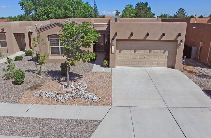 Stunning Single Story Sivage Thomas Pueblo Home - lovingly maintained &  beautifully cited on a fully landscaped lot in Vista Del Norte with mountain views. Conveniently located to all points in ABQ via I-25 & to Santa Fe via the Rail Runner. The lovely curb appeal welcomes you while the character & charm of this SW Casa bid you to stay awhile. The front entry opens into a large foyer w/raised ceilings, tiled floors & a large skylight. The foyer is the hub of the living spaces with the huge great room, the formal dining area, the kitchen & BK nook all open to each other with line of sight from front door to the lovely covered patio & lushly landscaped backyard with mountain views. The home has brand new stucco, custom lighting & tile & laminate throughout - no carpet! The open floor ..MORE