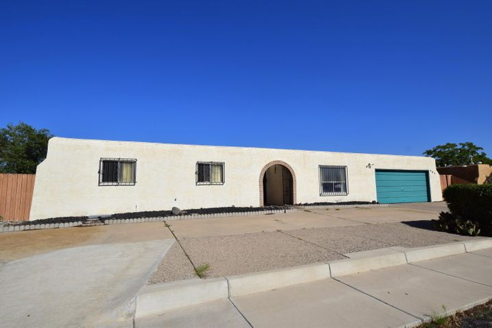 Great location right across the street from the Rio Rancho Elementary!  Needs some TLC but has all the elements that could make it a bright cheery house with a private backyard and already equipped with refrigerated air!  Home is sold as-is, priced to sell!