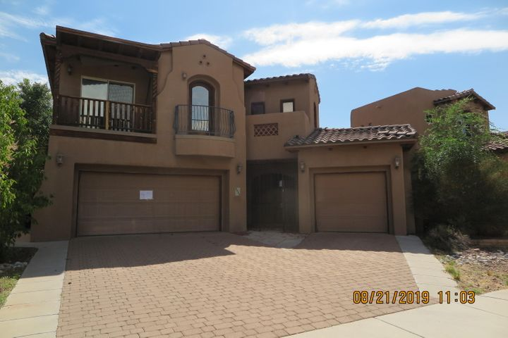 Amazing 2 level home just blocks from La Cueva HS. Located on dead end street this custom home features 2 master suites, one upstairs and one on the main Level.2 Additional bedrooms with balconies plus a seperate office area. Living/dining combo open to gourmet kitchen.Tankless waterheater plus refrigerated air.  Balcony's galore. Private backyard with covered patio. 3 car garage.