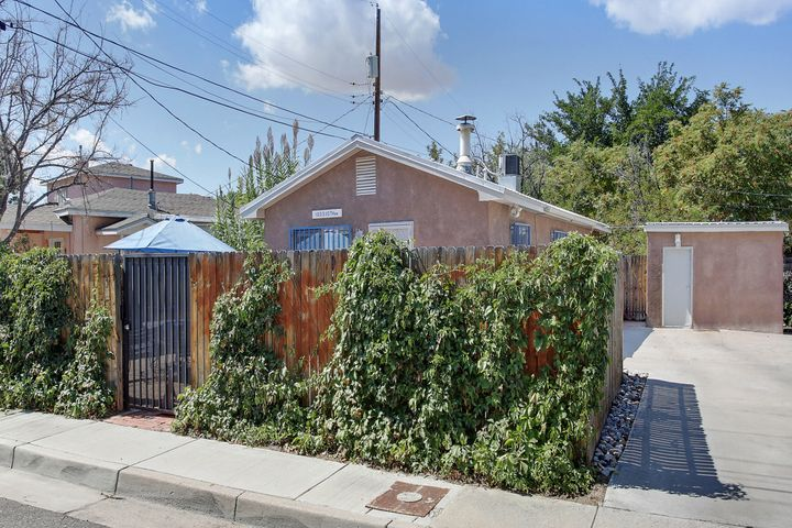 Immaculate Downtown Bungalow in the heart of historic Barelas.  This beautiful home is steps from trails, the Zoo and Tingley Park!!   Remodel was completed in 2014 and included both mechanical and cosmetic elements. Some of the items include metal roof, conversion to refrigerated air, updated kitchen and baths,  new flooring and appliances.  Water heater was installed in 2017.  The beautiful, private, front courtyard provides wonderful exterior space for entertaining and the detached building provides great storage.  Welcome Home!