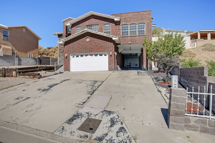 Few homes in ABQ have a million dollar view for this price! This home is perfect for hosting guests with a fully upgraded kitchen, two living areas, a large, private patio and game room. Come take a look and experience the vast beauty of the city, day and night, right from your master bedroom or front door!