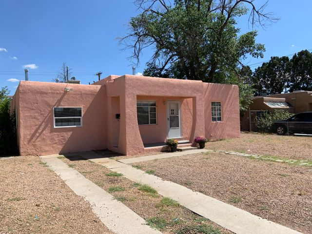 Nice spacious home in super convenient location, with new gas stove, dishwasher, garbage disposal, water heater, kitchen counters and sink.  Big walk in pantry and eating area in kitchen and access to very large fenced backyard with alley access. Attached 3rd bedroom has separate entrance from back yard and half bath and would work well for extended family, or private office. Additional 9' X 19' area off living room would make a great family room or additional bedroom. Main bathroom is nicely updated. Cove ceilings, arched doorway and built ins maintain much of the original charm.  Backyard is zoned for a casita !! Walking distance to stores and public transportation.