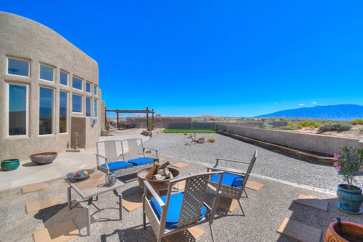 Your Search is Officially Over! Come and be captivated by the endless views of the beautiful Sandias. You'll take a couple extra minutes to imagine seeing the view of the Hot Air Balloons all year round and enjoying the amazing hues of an Albuquerque sunset. Located in a desirable custom home neighborhood, this home sits on .5 acre giving you space to grow. As you walk through, you'll notice all the thoughtful updates that elevate this home to be truly move in ready. The spacious kitchen is where you'll imagine entertaining and making memories around the large island. The bonus room is ready to fit any of your needs! Outside there is a pergola giving you a perfect place to unwind and enjoy the day. Don't Miss The Breathtaking Views and this Amazing Home, Schedule a Showing Today!