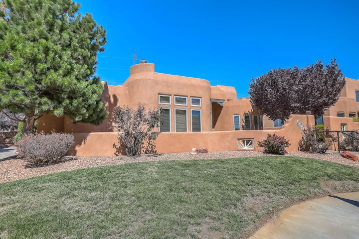 An Absolute Must-See! Beautiful home in the Las Alturas  gated subdivision in the near Northeast Heights. Close to UNM, Nob Hill, KAFB , downtown, and Altura Park.  Single level floor plan, 3/BR, 2BA, two car attached garage. Refrigerated air and many recent updates including new carpet, granite counter tops, quality stainless steel kitchen appliances and more! This is a home with so many great features that are hard to find in this high demand market. Wonderful courtyard entry ,large great room with  cathedral ceilings,  clerestory windows for lots of natural light, custom kiva style fireplace and a beautiful study with hard wood floors. Recent roof and stucco . You'll want to see this newly listed home soon. Call for an appointment today.