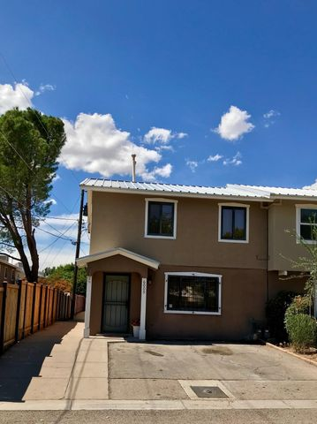 This charming 3 bedroom, 1.5 bath townhome is nestled into the heart of the North Valley! New flooring, paint, & light fixtures. Beautiful kitchen counters, and all appliances stay! Clean fully fenced backyard and covered patio. HOA is only $100/month and covers roof, exterior, streets, parks, and fences!! Walk to grocery store, bike the acequias to the river, or watch balloons from Los Poblanos Open Space! Possible air B&B? Come see - this place has so much to offer at such an affordable price!