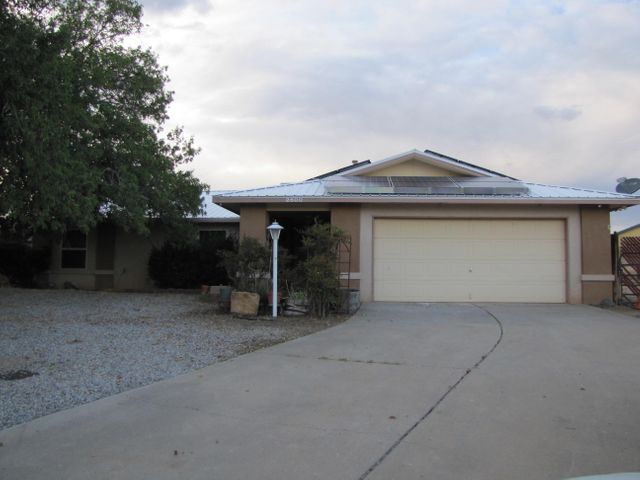 Great home situated in central Rio Rancho close to shopping and dining.  Located on a large lot with backyard access at the end of a  cul-de-sac.  Nice size kitchen with stainless steel appliances. With the solar panels installed, last months PNM bill was VERY low.   Don't miss the opportunity to own this home.
