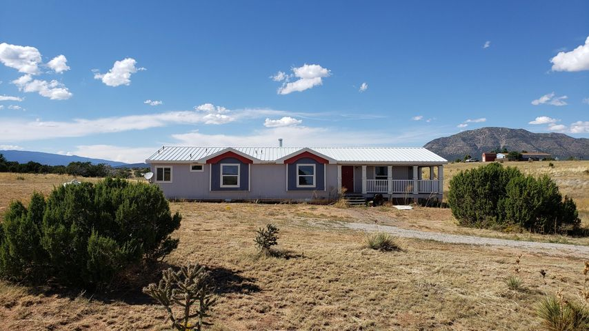 Newly updated home with wide open spaces! This cute 3 bedroom 2 bath is on a permanent foundation that sits on almost 3 full acres! Includes a recently replaced roof, new flooring throughout, as well as, a fresh coat of paint! Comes with refrigerated air and a wrap around deck for viewing the beautiful New Mexico skies! Please see Lo/So remarks for showing instructions.