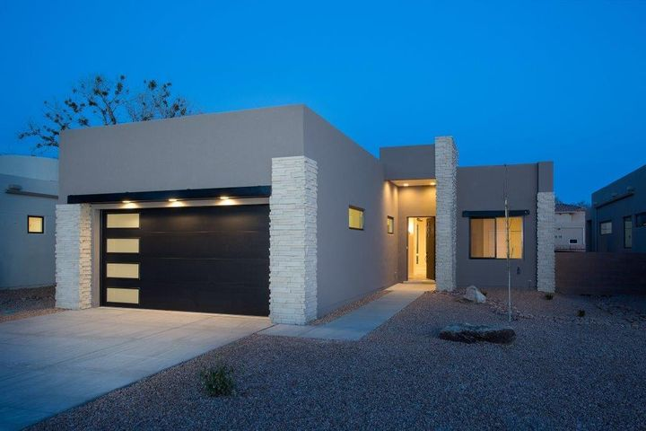 Incredible new construction in small gated community at the end of Campbell Road west of Rio Grande Blvd. Easy access to Bosque walking and biking trails. Close to Rio Grande Nature Center, Old Town, Downtown, Freeway access. This home has an oversized garage with room for storage or workshop. Garage is 27' x 21'. Home is cozy but also great for entertaining. Great flow with a large covered patio offering unique indoor/outdoor living opportunity. High end custom finishes including quartz counters, hand finished walls, Bosch Appliances, Pella wood windows, custom 8' foot doors, custom lighting...