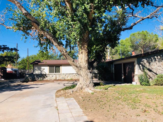 Back on the Market! Welcome to the beautiful North Valley. Take a look at this 4 bd/2 ba home with two living areas. This home is situated on a half-acre with backyard access. Near Bachechi open space and riverside trails. Home is being sold ''as is'' by Estate.