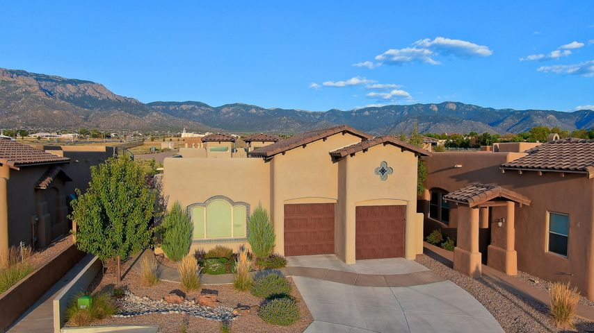 Stunning Panorama custom hm w/breathtaking views of the Sandia Mtns in a private gated community. Energy Silver Star & Green Built certified this upgraded home boast porcelain tile floors & decor ceiling, arches, nichos & two Cupola's. Great rm w/fireplace, custom mantle & full view windows w/custom blinds all open to the Gourmet kitchen w/Wolf 5 burner gas cooktop,JennAir Appliances, entertainers island & River Bordeaux granite countertops w/satin finish + lg nook/dining area. Master suite w/Mtn views, customized walk-in closet, jetted garden tub, snail shower & vanity seating.  Nice sized add'l bedrms & full bath w/frameless shower & granite counters + guest bath. Outdoor living w/built-in fireplace, decor tile accents, flagstone hearth seating & built-in Coyote BBQ w/granite surround.