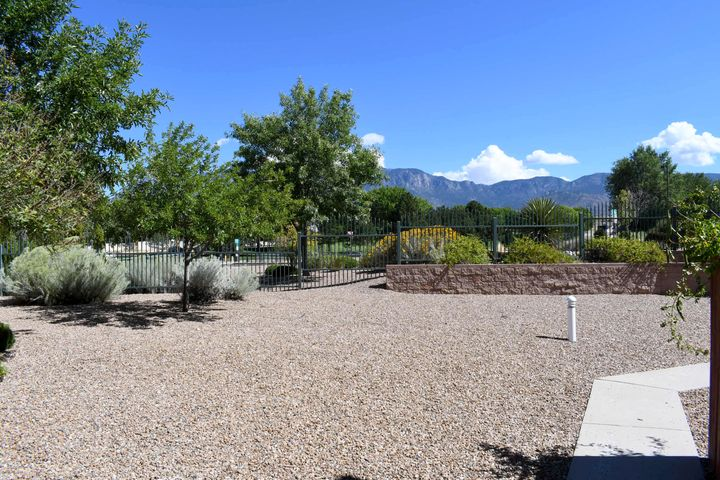 Great location with easy access to a park and bike trails, CNM, shopping and restaurants. This bright and open condo has been remodeled with a new AC and furnace and  a water heater in 2017.  New SS appliances including microwave, refrigerator and dishwasher.  New carpet throughout, lots of fresh paint.  Enjoy the privacy and security  Oso Park Condominiums.
