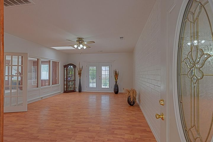 Remodeled! Refreshed! Renewed! New granite countertops, fresh paint, brand new roof, new furnace & refrigerated A/C master cool! Great NE heights home with tons of character! Handsome wood flooring with built in book shelves & exposed brick walls. Cozy fireplace in the dining room Skylights bring in tons of natural light! French doors to an extended covered patio and grassy backyard! Located in Sandia High District, near uptown, shopping and restaurants! RV parking! Upgraded electrical panel for maximum efficiency! All repairs complete!